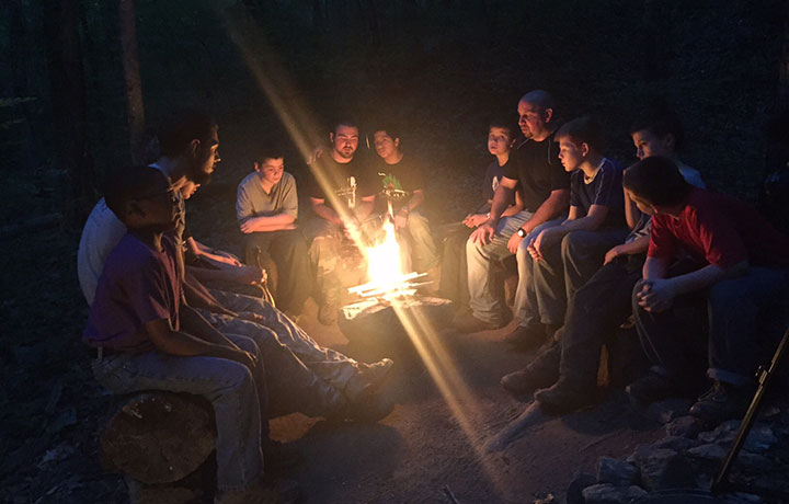 Boys around campfire