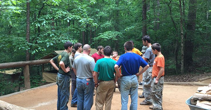 boys circling up at camp to resolve problems